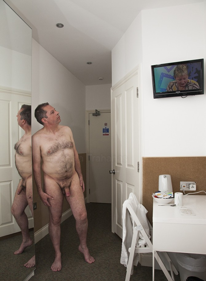 Naked man in hotel room