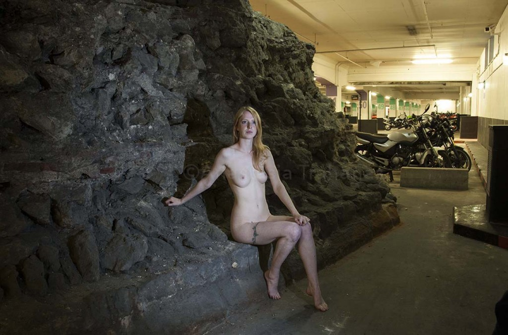 Naked woman in car park