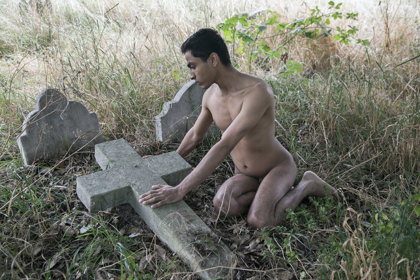 naked man in cemetery