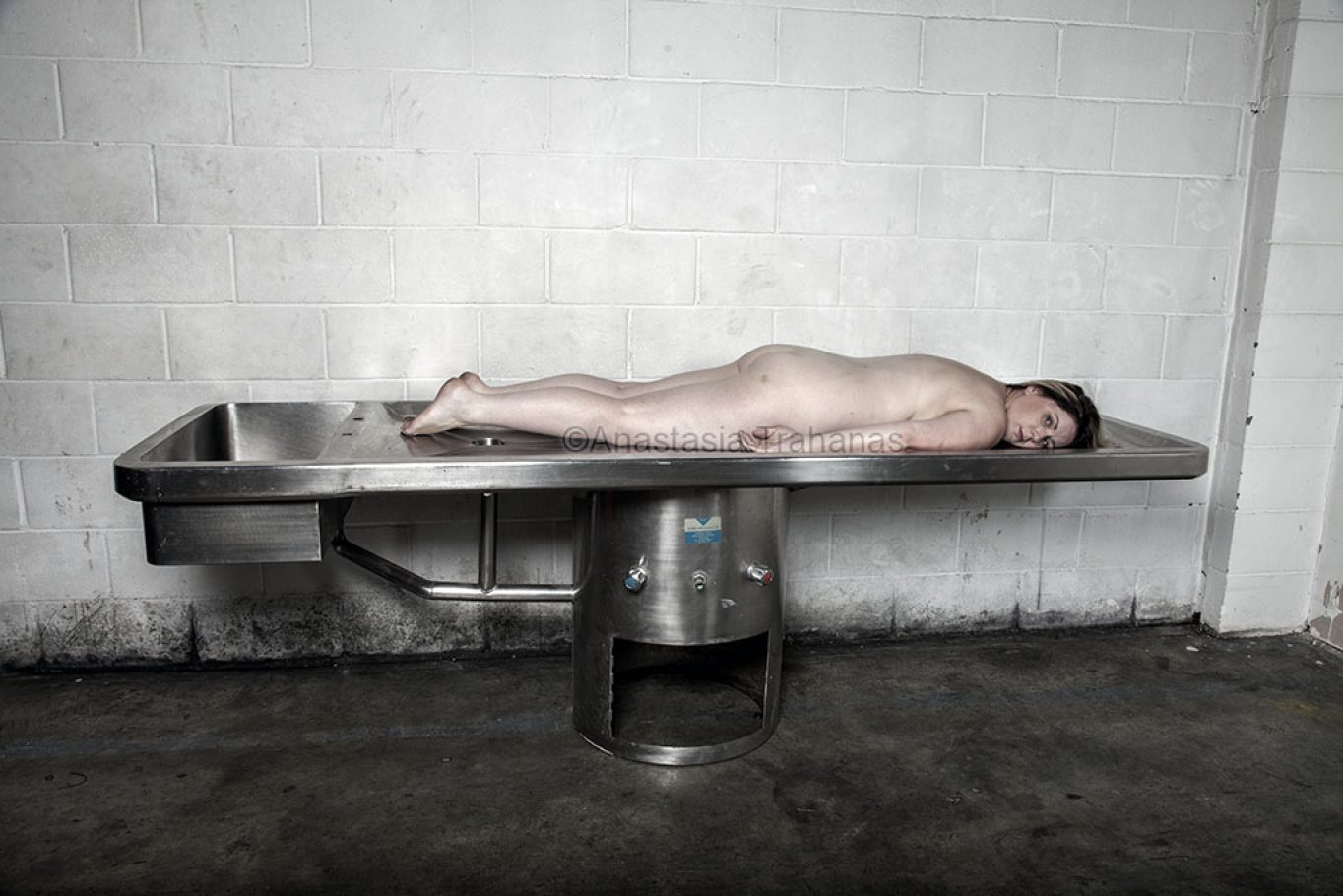 Naked woman on mortuary table