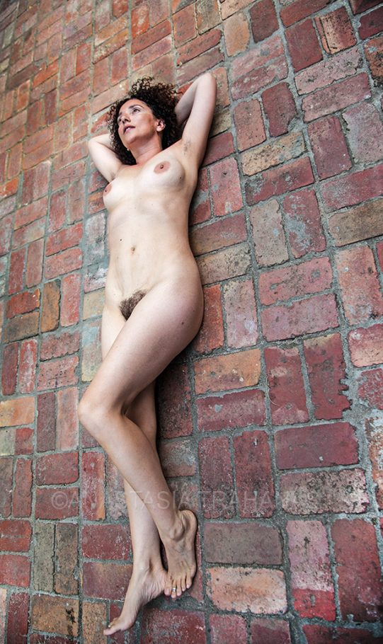 woman laying on red bricks ground