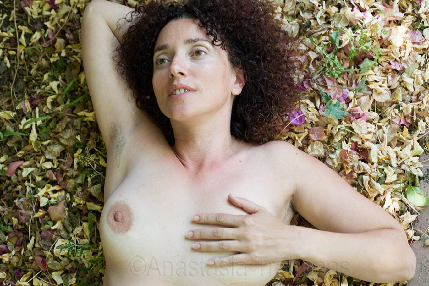 nude woman with hand on breast