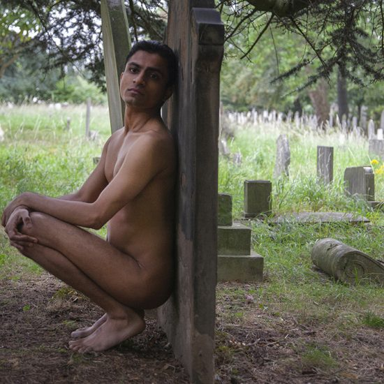 nude man in cemetery