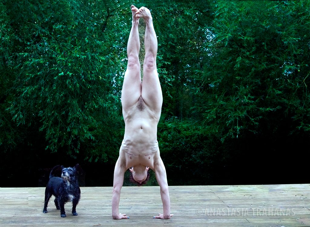 nude woman doing hand stand